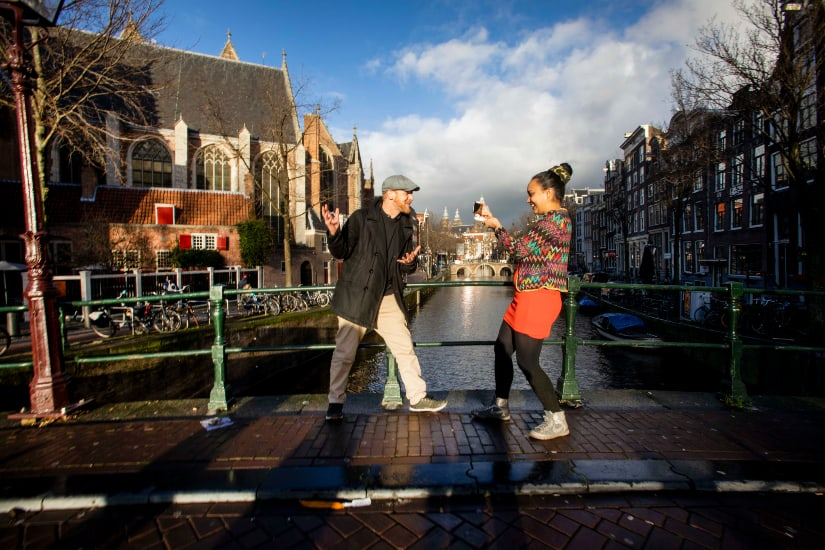 Virtual tour in Amsterdam, guide and camera on the bridge